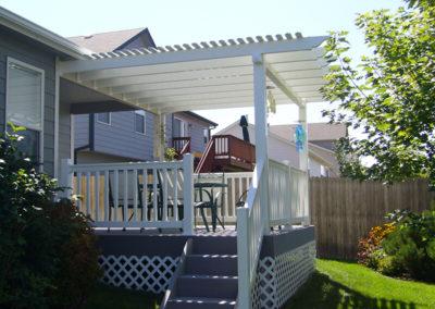 white pergola and patio set