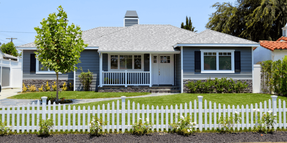 home with decorative picket fence